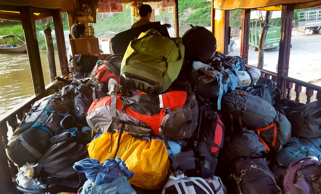 Backpacks out of the hold prepared for landing in Pak Beng, Laos