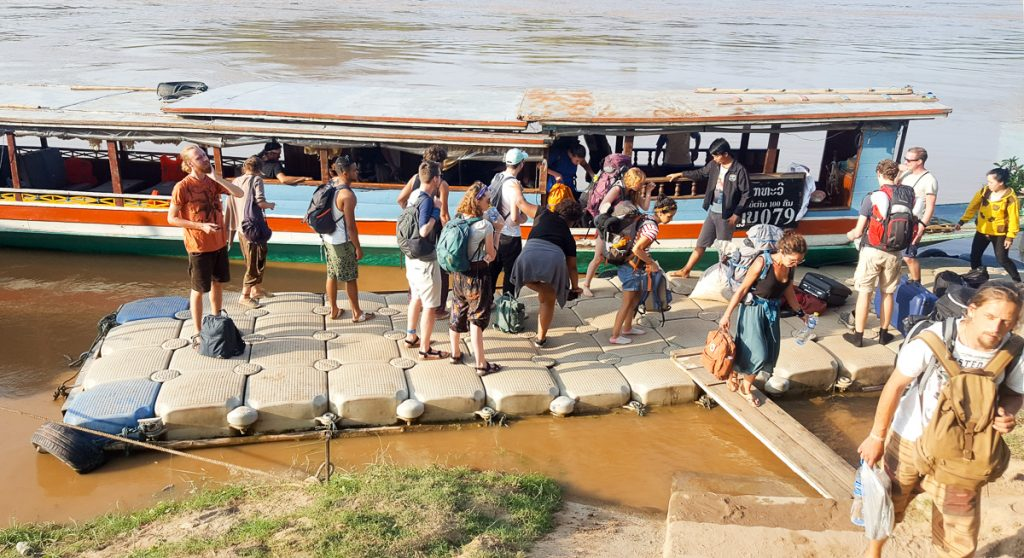 Tourists getting off the slow boat pier outside Luang Prabang, Laos