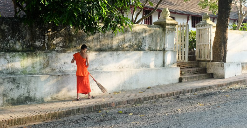 Buddhist monk sweeping